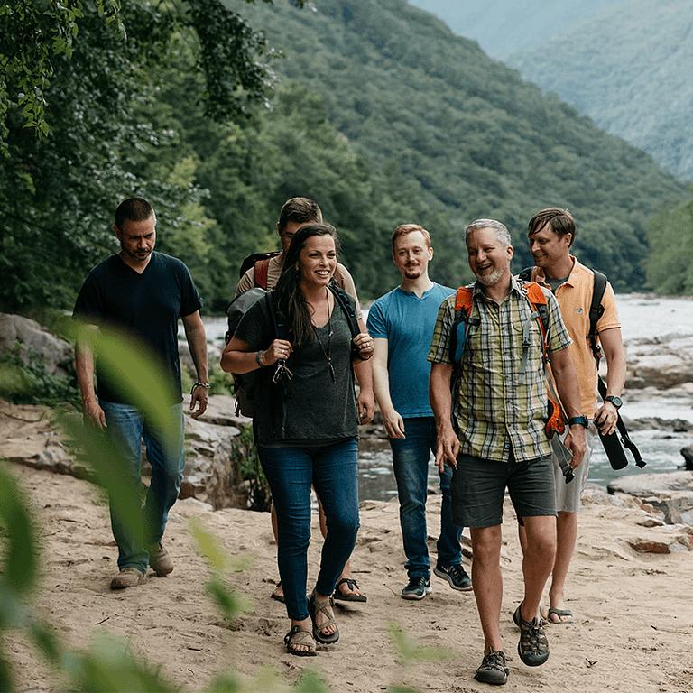 Ntarians walking along the Nolichucky river.