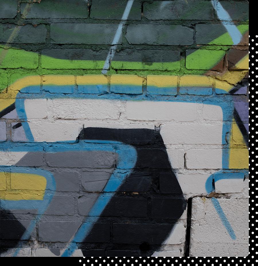 Colorful graffiti on a brick wall.